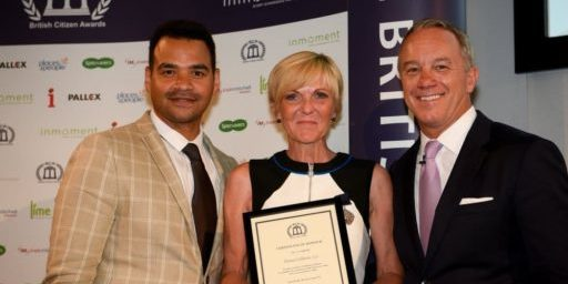 Fiona Coldron holding British Citizen Award certificate while standing next to Lonnie Mayne and Michael Underwood